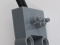 Lego alkatrész - Dark Bluish Gray Pneumatic Switch with Pin Holes and Stepped Outlets